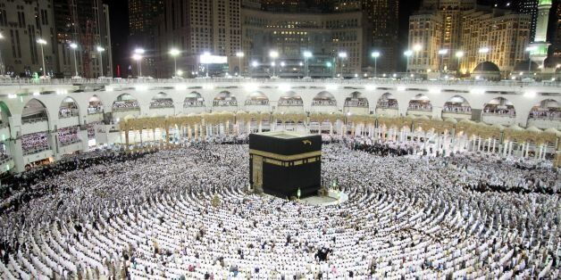 Muslim worshippers pray at the Kaaba, Islam's holiest shrine, at the Grand Mosque in Saudi Arabia's holy...