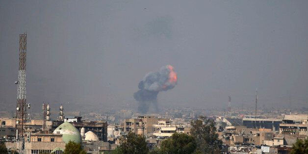 Fire and smoke billow following a reported car bomb explosion as Iraqi forces clash with Islamic State...