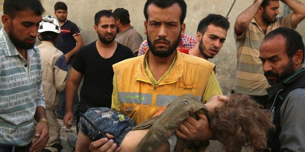 ATTENTION EDITORS - VISUAL COVERAGE OF SCENES OF INJURY OR DEATHA medic holds a dead child after airstrikes...