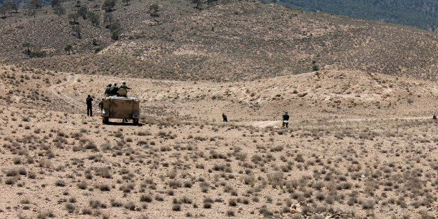 Tunisian soldiers patrol near the border with Algeria as seen from in the area of Mount Chambi, west...