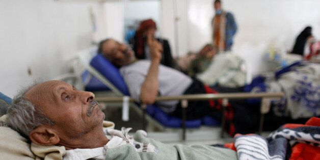 A man lies on the bed of a cholera treatment center in Sanaa, Yemen May 15, 2017. Picture taken May 15,...