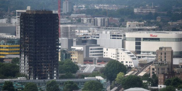 The burnt out remains of the Grenfell apartment tower are seen in North Kensington, London, Britain,...