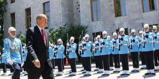 ANKARA, TURKEY - JULY 15: Turkish President Recep Tayyip Erdogan (front) walks past the honor guards...