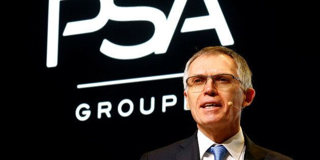 Carlos Tavares, Chairman of the Managing Board of French carmaker PSA Group addresses the media during...