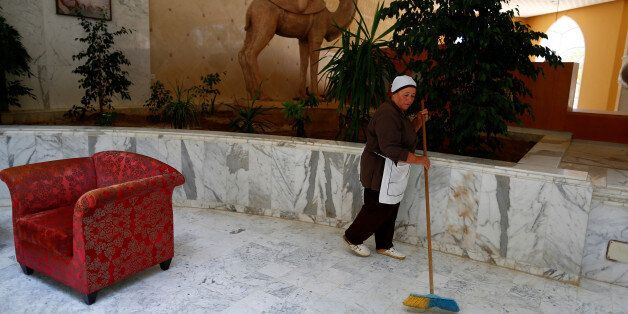 Khadidja, 60, the only housekeeper kept at her job to maintain the cleanliness of the Imperial Marhaba...