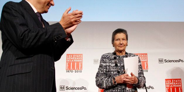 French Prime Minister Francois Fillon (L) applauds as French politician and Academician Simone Veil arrives...