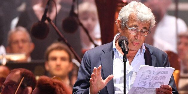 French actor Michel Boujenah reads a text, on stage, during a commemorative ceremony marking the first...