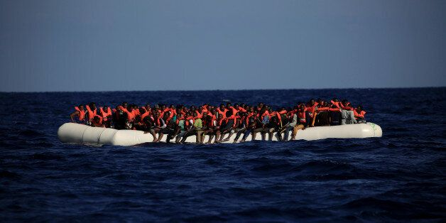 An overcrowded dinghy with migrants from different African countries is seen after members of the German...
