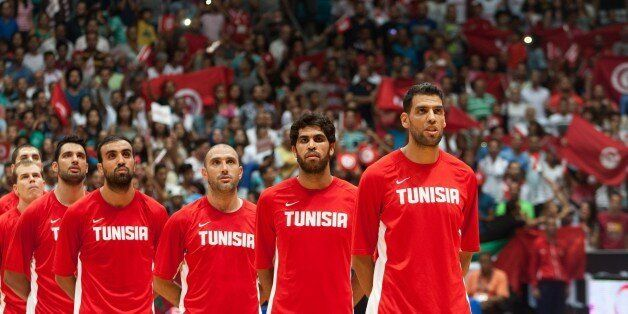 RADES, TUNISIA - AUGUST 29: Tunisia's players sing national anthem before the 2015 FIBA Afrobasket Championship...