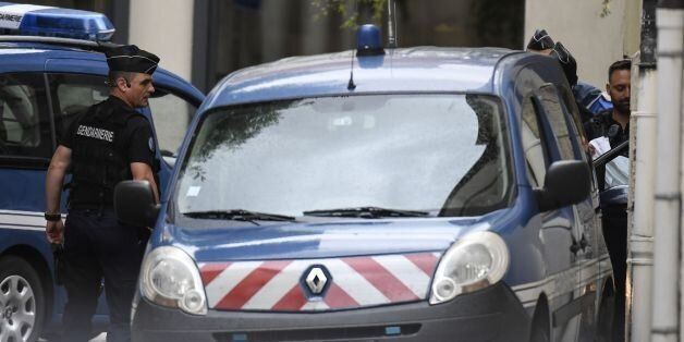 French gendarmes prepare to escort a vehicle carrying Murielle Bolle (not pictured) outside the courthouse...