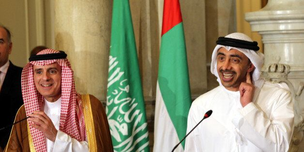 UAE Minister of Foreign Affairs and International Cooperation Abdullah bin Zayed Al-Nahyan (R) talks...