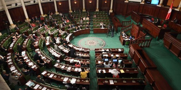 Tunisian MPs attend a parliament session for the revision by the Tunisian assembly of the bill amending...