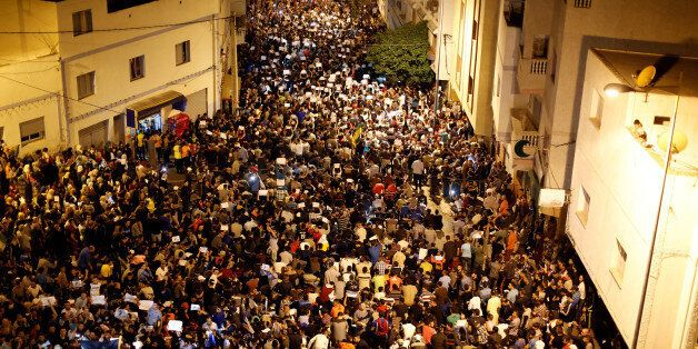 Thousands of Moroccans shout slogans during a demonstration in the northern town of Al-Hoceima against...