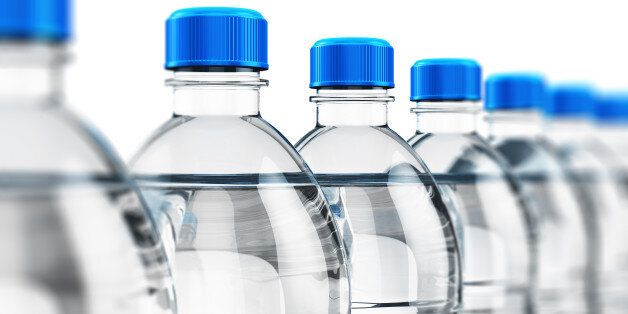 3D render illustration of the row of plastic bottles with clear purified drink carbonated water isolated...