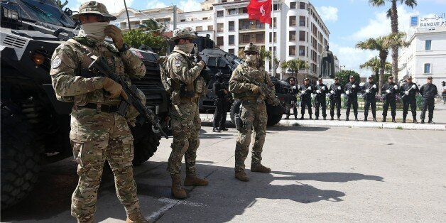 TUNIS, TUNISIA - MARCH 08: Tunisian soldiers take security measures during the opening of Battle of Ben...
