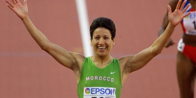 Nezha Bidouane of Morocco reacts after winning the women's 400 meterhurdles final at the World Championships...