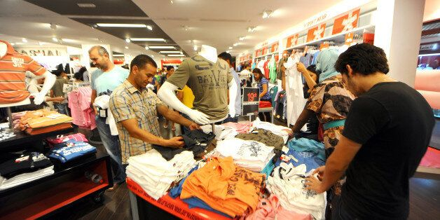 Tunisians shop at a shopping center in Tunis on July 28, 2011. Food and textile prices have risen ahead...