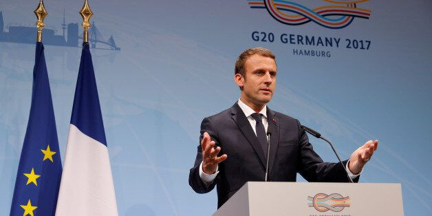 French President Emmanuel Macron gestures during the press conference at the G20 leaders summit in Hamburg,...