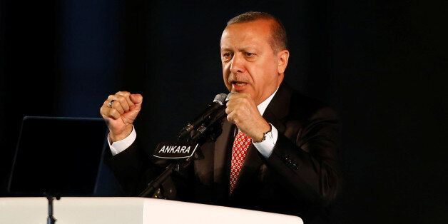 Turkey's President Tayyip Erdogan addresses his supporters during a ceremony marking the first anniversary...