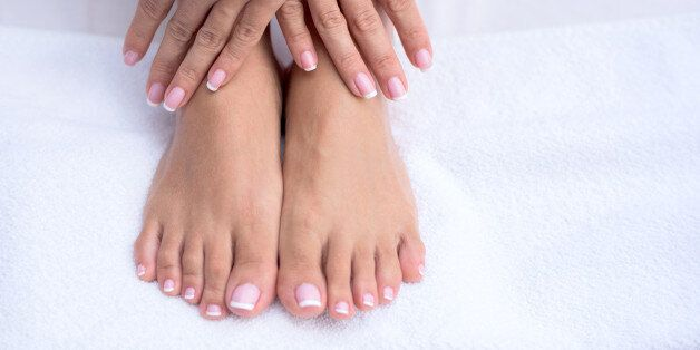 Manicure and pedicure concepts - close up on hands and feet at the beauty