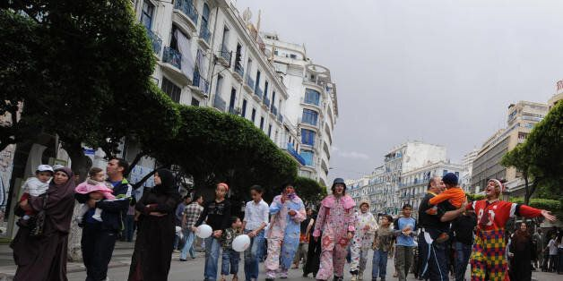 Algerian children with their families walk in Algiers' main street of Didouch Mourad on May 16, 2008...