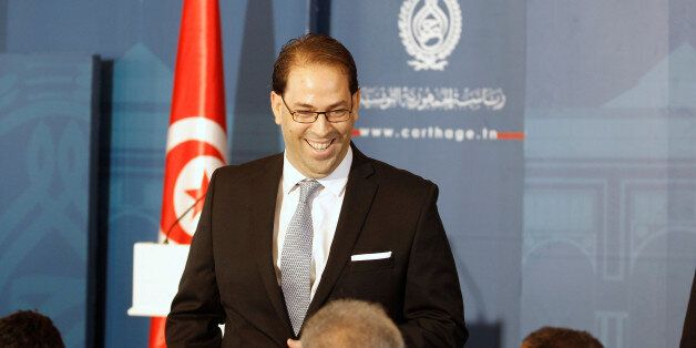 Tunisia's Prime Minister-designate Youssef Chahed smiles during a news conference after his meeting with...