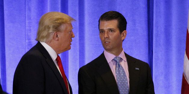U.S. President-elect Donald Trump speaks with his son Donald Trump Jr. during a news conference in the...