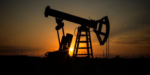 Fossil Fuel Energy, Oil Pump, Pumpjack, Old Pumping Unit, Jack Pump, Sunset.Rows of oil donkey in silhouette...