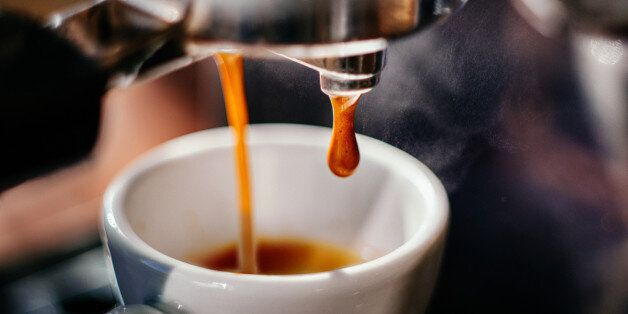 Fresh espresso shot pouring out of