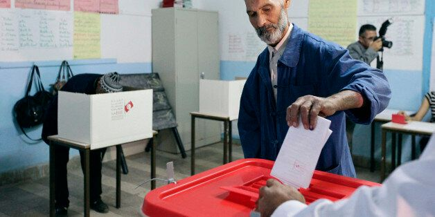 A man casts his vote at a polling station in Tunis October 26, 2014. Tunisians elect a new parliament...