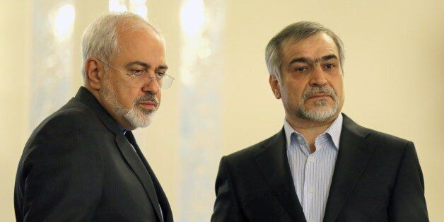 Iranian Foreign Minister Javad Zarif (L) and Hossein Fereydoun, President Rouhani's younger brother and...