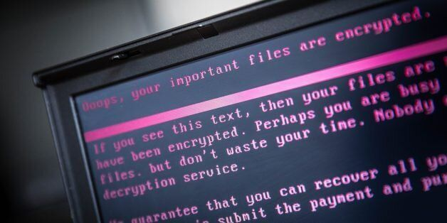 A laptop displays a message after being infected by a ransomware as part of a worldwide cyberattack on...