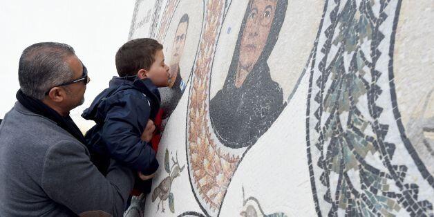 TOPSHOT - Mohamed, the son of Tunisian policeman Aymen Morjane who got killed last year in a jihadist...