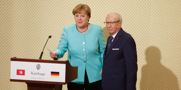 German Chancellor Angela Merkel gestures after a news conference with Tunisia's President Beji Caid Essebsi...