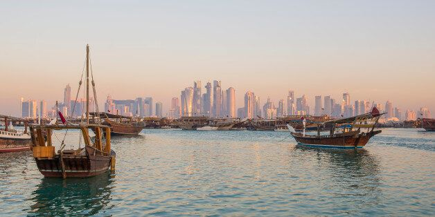 Traditional boats ( Dhows ) with background of Doha skyline ,