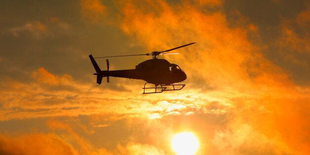 Silhouette of military helicopter at