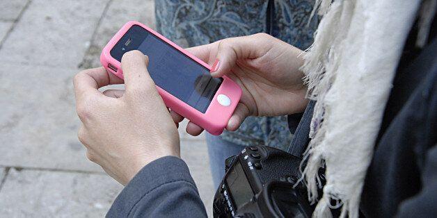 COPENHAGEN /DENMARK- Danish crime reporters and photographer using their smartphones to reporter to net...