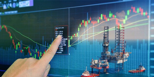 Stock market concept with oil rig in the gulf and oil refinery industry background,Double