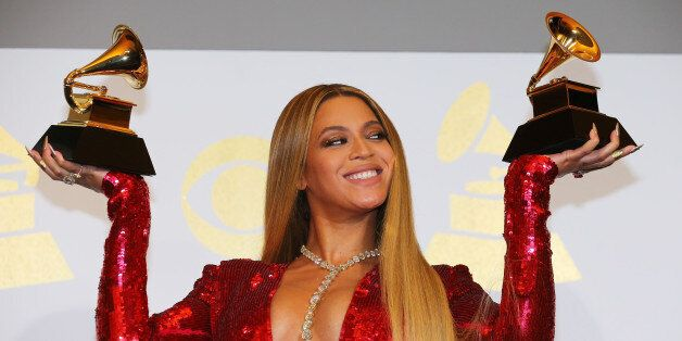 Beyonce holds the awards she won for Best Urban Contemporary Album