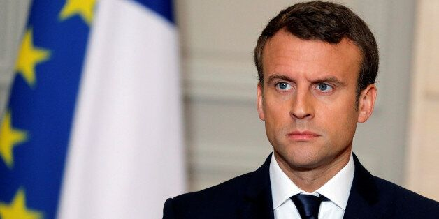 French President Emmanuel Macron attends a press conference at the Elysee Palace in Paris, France, June...