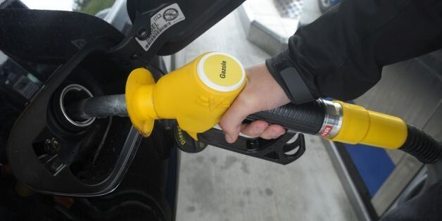A person pump diesel gasoline on May 29, 2017 at a petrol station in Brest, western France. / AFP PHOTO...