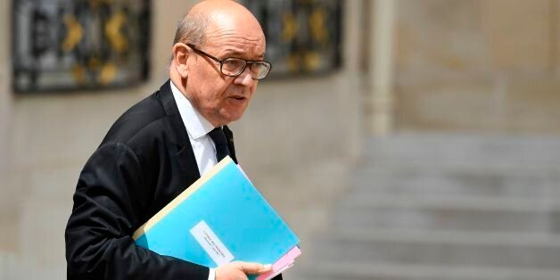 French Minister of Europe and Foreign Affairs Jean-Yves Le Drian leaves a cabinet meeting on June 7,...
