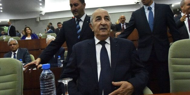 Prime Minister Abdelmadjid Tebboune (C) unveiled the main lines of the government's action plan to members...