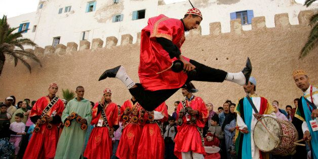 A dancer performs during the annual Gnaoua Music Festival in Essaouira June 25, 2009. The festival features...