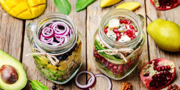 homemade healthy salads with vegetables, fruits, beans and quinoa in jar. toning. selective