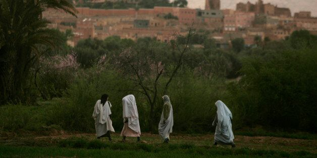 Women return to their houses at dusk in Todra Oasis, near Tinerhir March 9, 2009. When some Moroccan...