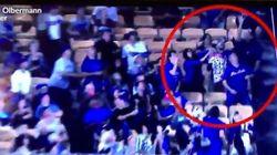 Ce fan de baseball a eu un réflexe stupide, sa femme le lui a bien fait