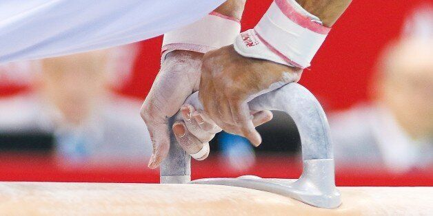 BAKU, AZERBAIJAN - MAY 15: Arican Ferhat of Turkey competes in the Men's Pommel Horse Final during day...