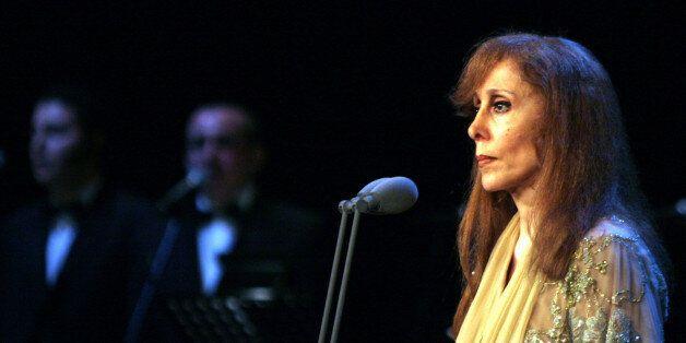 Lebanese singer Fairuz performs at the Emirates Palace theatre in Abu Dhabi, May 18, 2006. Fairuz sang...