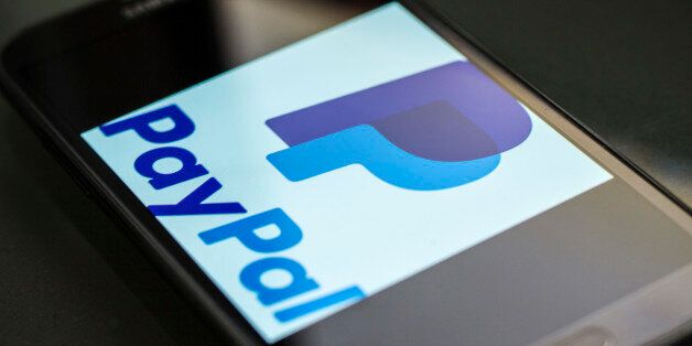 The new PayPal logo on a smartphone. PayPal is an e-commerce company that transfers payments over the...